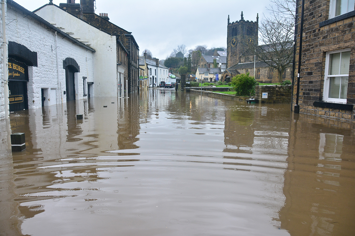 How does flooding impact property valuations?
